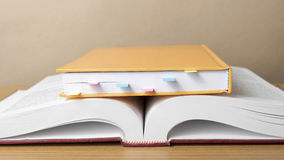 Orange book with sticky note Royalty Free Stock Photos