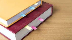 Orange book with sticky note Stock Photos