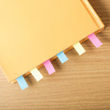 Orange book with sticky note Royalty Free Stock Photography