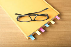 Orange book with sticky note Royalty Free Stock Image