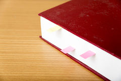 Orange book with sticky note Royalty Free Stock Photo