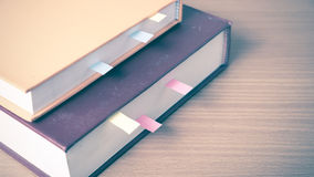 Orange book with sticky note Stock Photo