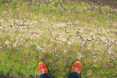 Orange boots on ground from above Stock Photography