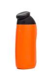 Orange  bottles with black cap Stock Images