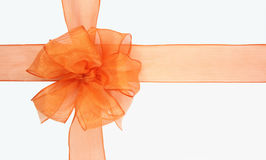 Orange bow. On a white background Royalty Free Stock Image