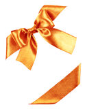 Orange bow from silk ribbon Stock Photography