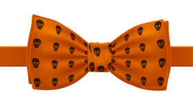 Orange bow tie with skulls pattern print. Stock Photography