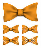 Orange bow tie with white dots realistic vector illustration set. Isolated on white background Stock Photos