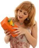 Orange box. Happy girl with orange gift box Royalty Free Stock Image