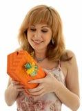Orange box #2. Happy girl with orange gift box Royalty Free Stock Image