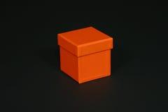 Orange box. On black background royalty free stock photo