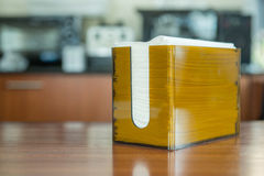 Orange box with napkin in coffee shop Royalty Free Stock Image