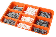 Orange box organizer for the screws, dowels, self-tapping washers isolated on white Royalty Free Stock Photo