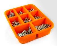 Orange box of screws on white background 02 Stock Photos