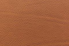 Orange-braune körnige, starke Kornkalbkuhlederbeschaffenheit und -hintergrund lizenzfreies stockfoto