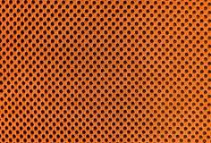 Orange breathable poröst poriferous material för luftventilation med hål Materiell nylontextur för Sportswear arkivfoto