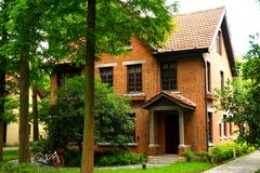 An Orange brick European style house in the woods Stock Photography