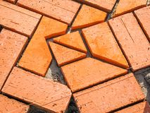 Orange brick paving stones in construction process Royalty Free Stock Images