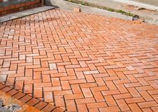 Orange brick paving stones in construction process Royalty Free Stock Photos