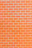 Orange brick wall as a nicely textured background Stock Photos