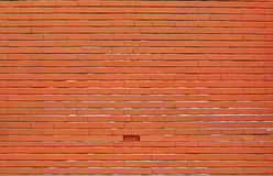 Orange brick wall background with a missing brick Royalty Free Stock Photo