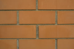 Orange brick wall close-up background Royalty Free Stock Image