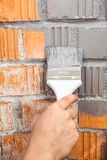 Orange brick wall painted with grey color Royalty Free Stock Photos