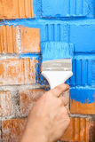Orange brick wall painted with light blue color Royalty Free Stock Image