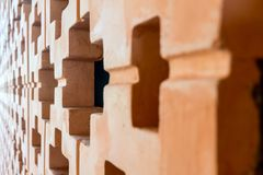 Orange brick wall pattern in perspective view. With depth of field Stock Images