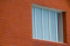 Orange brick wall with window. Right stock photos
