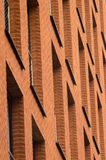 Orange brick wall with windows of modern building Stock Photography