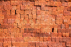 Orange bricks waiting to be used in construction in Thailand Royalty Free Stock Photos