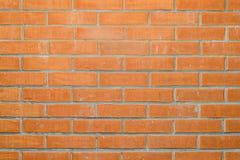 Orange brickwork with spots Stock Photo