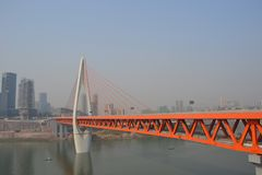 Orange Bridge in Chongquin, China. This is an orange bridge crossing a river in Chongquin, China royalty free stock photography