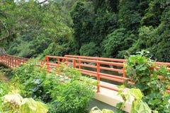 Orange bridge and Green plants Stock Image