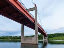 Orange bridge Jedleseer Steg across the Neue Donau in Vienna Austria. On a cloudy day in summer Stock Photos