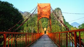 The orange bridge in Vang Vieng, Laos. The orange bridge over the Nam Xong Song River in Vang Vieng, Laos Royalty Free Stock Photography