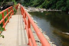 Orange bridge on the river Royalty Free Stock Photography