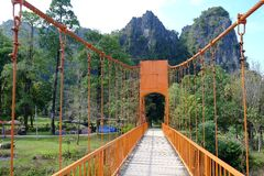 The orange bridge through to the mountain at Vang Vieng Laos. The orange bridge through to the mountain nice view and Stock Images