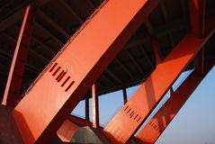 Orange bridge trestle and blue sky. Power and stability Stock Photos