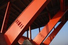Orange bridge trestle and blue sky Stock Photos
