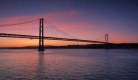 Orange bridge. Wonderful evening on April 25th bridge in Lisbon Royalty Free Stock Photos