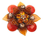 Orange brooch. Red and orange brooch over white background Royalty Free Stock Photos