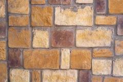 Orange Brown decorative Tiles Brick Wall Stock Photo