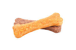 Orange and brown dog bone isolated on white background Stock Images