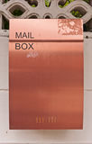Orange brown metal mailbox on wall Stock Images