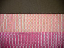 Orange brown and pink polka dot background Stock Photos