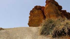 Orange brown red cliff and grass scenery stock footage