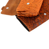 Orange and brown wallets Royalty Free Stock Photos