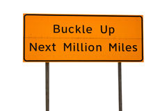 Orange Buckle Up Next Million Miles Sign Royalty Free Stock Photos
